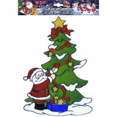 Kerstman bij boom raamsticker herbruikbaar kerstversiering